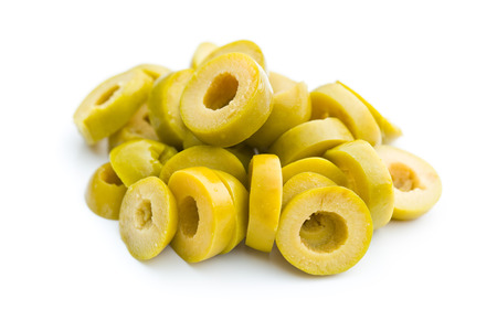 sliced green olives on white background