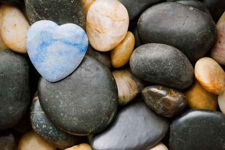 heart of stone: stone heart lying on other stones