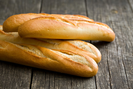 life loaf: french baguettes on old wooden background