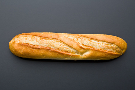 french baguette on black background