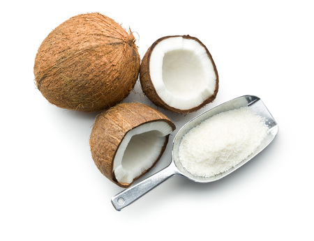 shred: grated, whole and halved coconut on white background