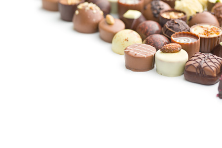 chocolate candy: various chocolate pralines on white background
