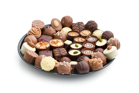 assortment: various chocolate pralines on black plate