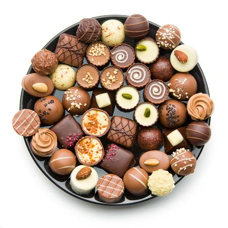 various chocolate pralines on black plate