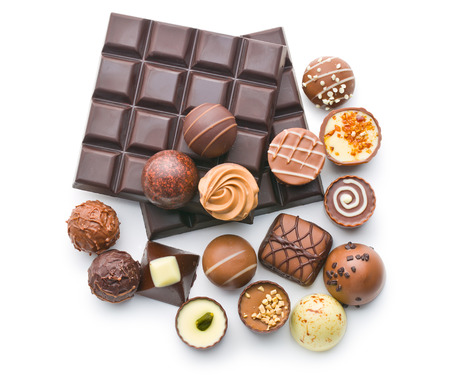 various chocolate pralines and chocolate bar on white background Banque d'images