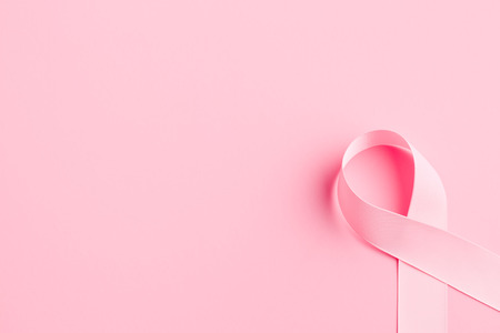 pink ribbon breast cancer on pink background Stock Photo