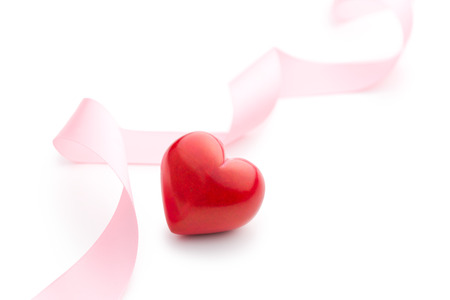 heart background: pink ribbon with red heart on white background
