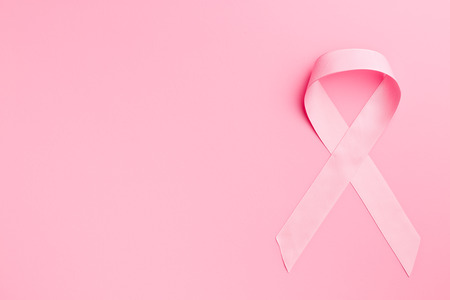 pink ribbon breast cancer on pink background Archivio Fotografico