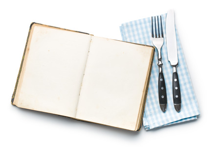 cutlery: vintage book and cutlery on white background