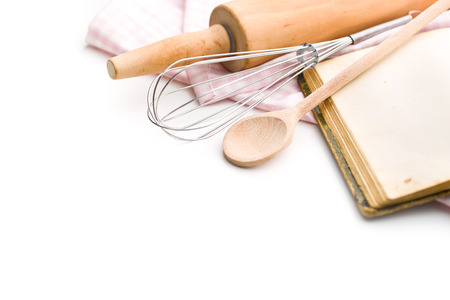 recipe book and kitchen utensils on white background Foto de archivo