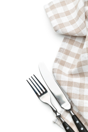 white napkin: knife, fork and checkerd napkin on white background