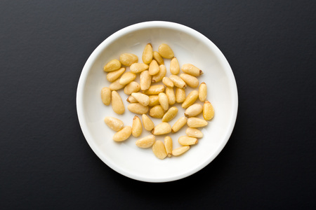 pine nuts: pine nuts in white bowl