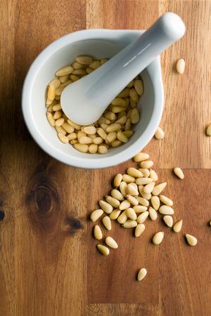 pine nuts: pine nuts in ceramic mortar
