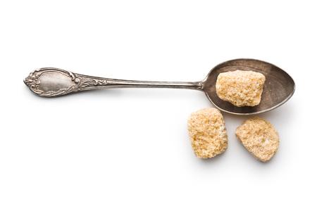 unrefined: unrefined cane sugar in silver spoon