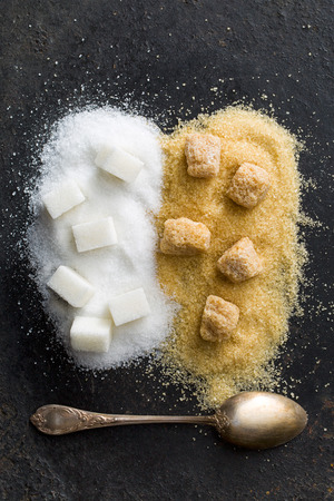 unrefined: top view of unrefined cane and white sugar