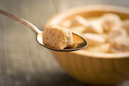 cane sugar: unrefined cane sugar in silver spoon