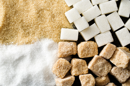 unrefined: top view of unrefined cane and white sugar