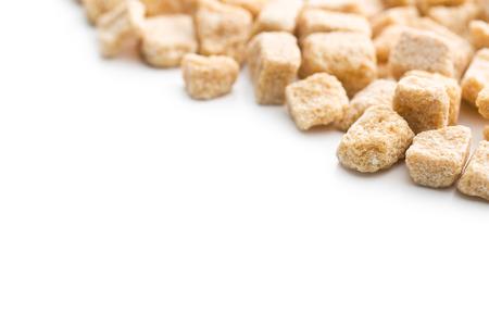 cane sugar: unrefined cane sugar cubes on white background Stock Photo
