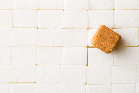 sugar cube: the brown cane sugar cube on white sugar cubes Stock Photo