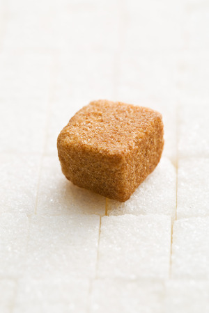 sugar cube: brown cane sugar cube on white sugar cubes Stock Photo