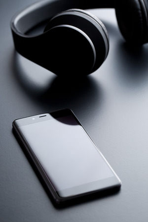 electronic music: the cellphone and wireless headphones Stock Photo