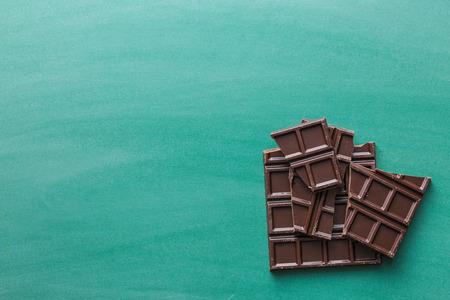 the dark chocolate bars on chalkboard Stock Photo