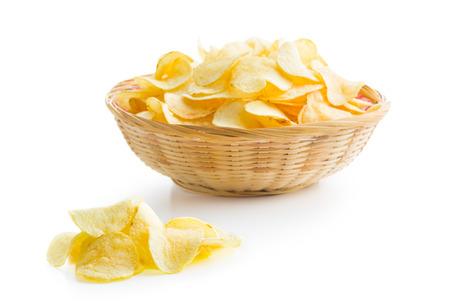 prepared potato: Crispy potato chips on white background Stock Photo