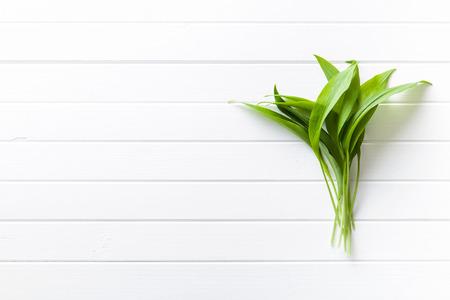table wood: Fresh ramsons leaves. Wild garlic leaves. Healthy vegetable.