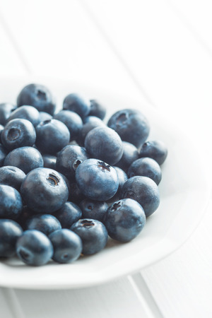 antioxidant: Tasty blueberries fruit in bowl. Blueberries are antioxidant organic superfood.