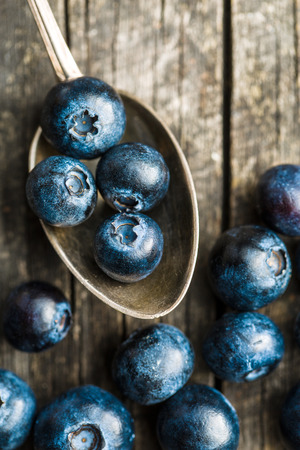 antioxidant: Tasty blueberries fruit in silver spoon. Blueberries are antioxidant organic superfood. Top view.