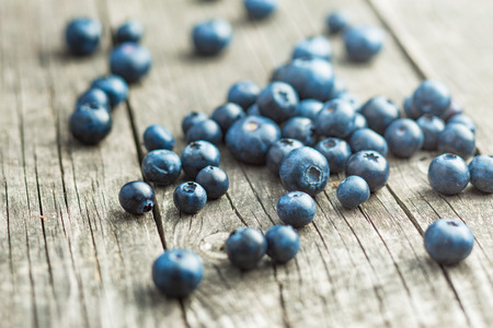 antioxidant: Tasty blueberries fruit on old wooden table. Blueberries are antioxidant organic superfood.