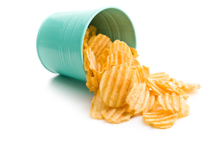 crinkle: Crinkle cut potato chips isolated on white background. Tasty spicy potato chips. Stock Photo