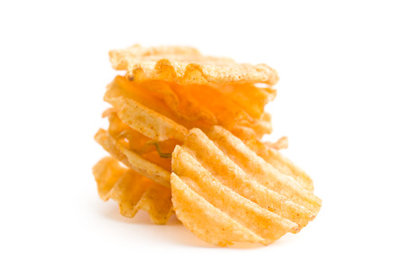 crinkle: Crinkle cut potato chips isolated on white background. Pile of tasty potato chips.