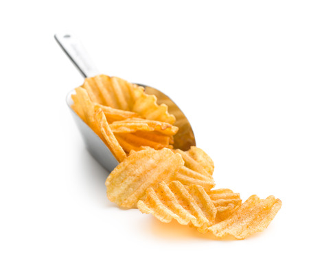 crinkle: Crinkle cut potato chips isolated on white background. Tasty spicy potato chips in scoop.