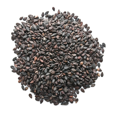 Black sesame seeds. Healthy sesame seeds isolated on white background. Top view.
