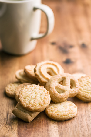 biscuits: Sweet butter biscuits. Cookies on wooden table.