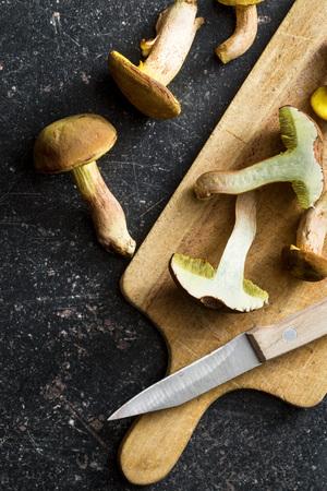 fungi woodland: Autumn harvest of fresh woodland fungi with boletus mushrooms on old kitchen table. Stock Photo