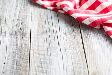 cocina vieja: The checkered napkin on old kitchen table.