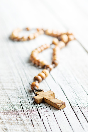 rosary beads: The wooden rosary beads on old table. Stock Photo