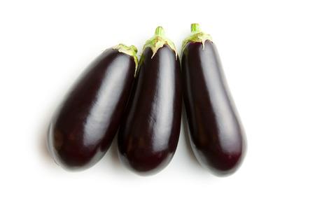 three fresh eggplants isolated on white background