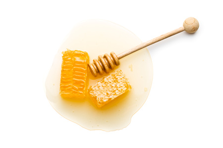 Fresh honey with honeycomb isolated on white background.