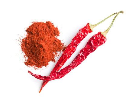 Chili pepper and powdered pepper isolated on white background. Stock Photo