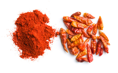 legumbres secas: Chili pepper and powdered pepper isolated on white background. Foto de archivo