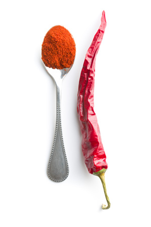 powdered: Chili pepper and powdered pepper isolated on white background. Stock Photo