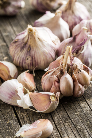 spiciness: Tasty garlic on old wooden table. Stock Photo