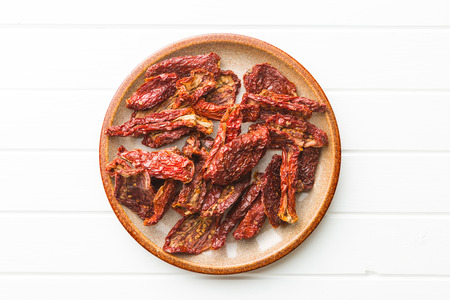 dehydrated: Tasty dried tomatoes on plate.