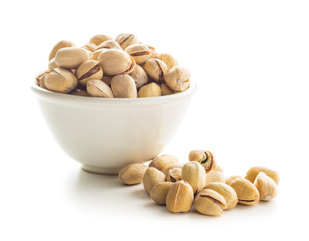 The pistachio nuts isolated on white background. Stock Photo