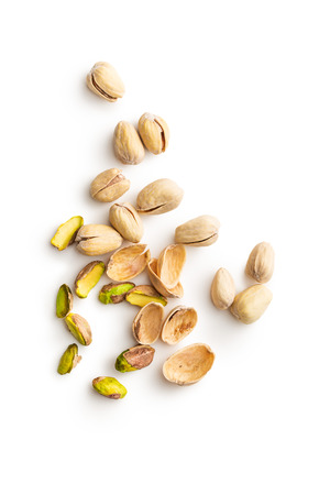 Peeled pistachio nuts isolated on white background. Top view. Stock Photo
