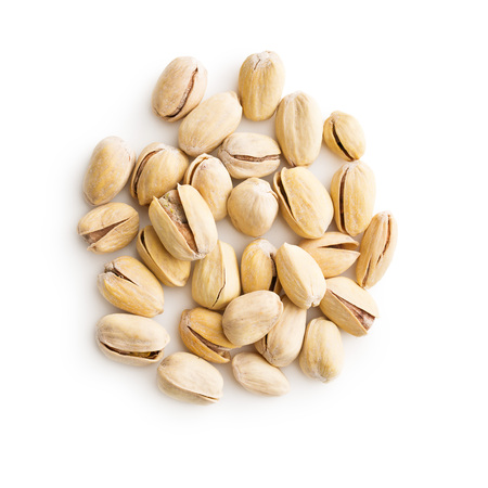 nutshells: The pistachio nuts isolated on white background. Top view. Stock Photo
