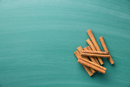 cinnamon stick: Cinnamon stick on green chalkboard. Top view.